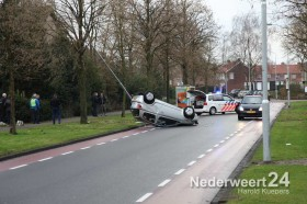 Auto over de kop Sint Jobstraat Weert