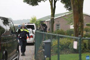 Politie doorzoekt loods in Ospel