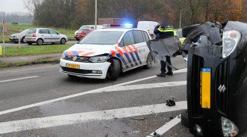 Politie botst bij Kelpen-Oler, personenauto op z'n kant